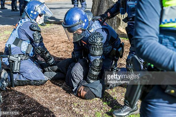 An anti fascist is held down to the ground by police as he is arrested during a protest organized by the antiIslam True Blue Crew supported by the...