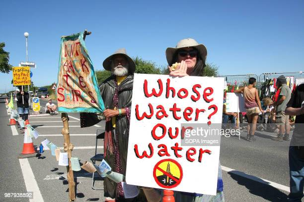 An Anti Fracking Protester dressed as a Lord of the Rings character Gandalf the Wizard holds a banner reading Don't Frack The Shires outside the gas...