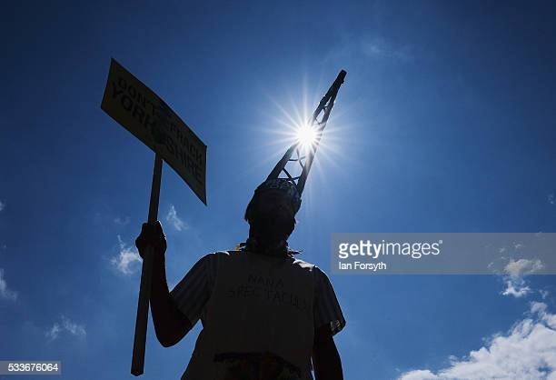 An anti fracking protestor wears a drilling derrick shaped hat as he waits in the grounds of the County Hall building in Northallerton for a decision...