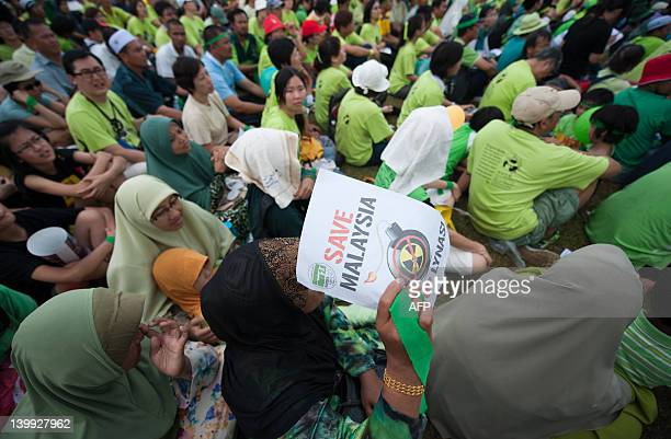 An anti Lynas activist displays a placard during a Green Gathering 20 in Kuantan some 260 kilometers east of Kuala Lumpur on February 26 2012...