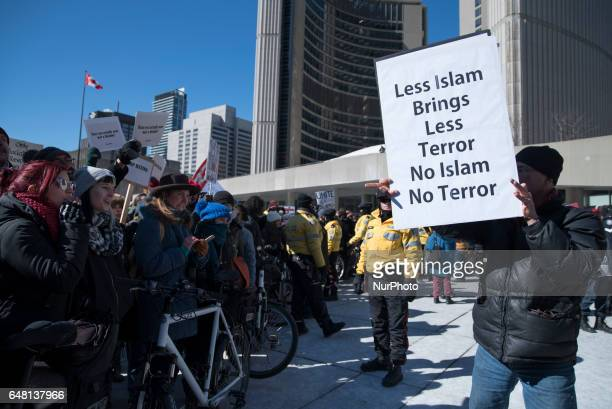An Anti Muslim protester arguing with Pro Muslim supporters during a rally where anti-Muslim and pro- Muslim protesters came together to protest at...
