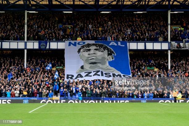 An anti racism banner is unfurled in the Glwadys Street Stand before for the Premier League match between Everton and Manchester City at Goodison...