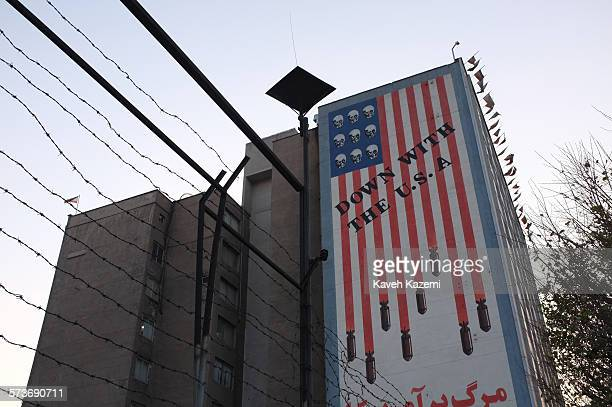 An anti US mural in Karim Khan street reads Down with the USA which is stamped on a large artwork of the American flag with bombs falling out of the...