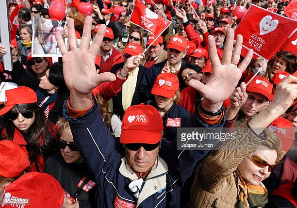 An antiabortion activist holds up his hands during a church backed antiabortion demonstration on March 29 2009 in Madrid Spain A new abortion...