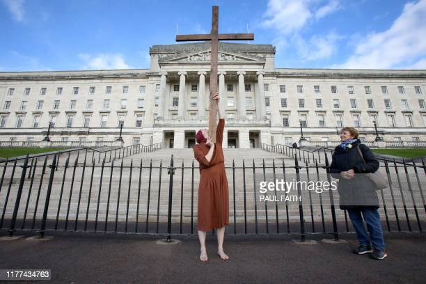 An antiabortion activist poses for a photograph whilst demonstrating outside of Parliament Buildings the seat of the Northern Ireland Assembly on the...