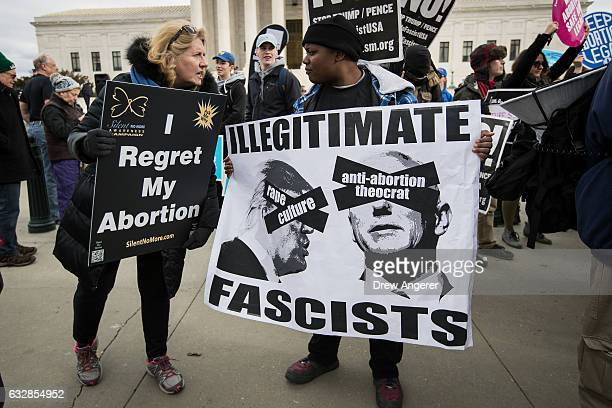 An antiabortion advocate talks with a prochoice advocate in front of the Supreme Court during the March for Life January 27 2017 in Washington DC...
