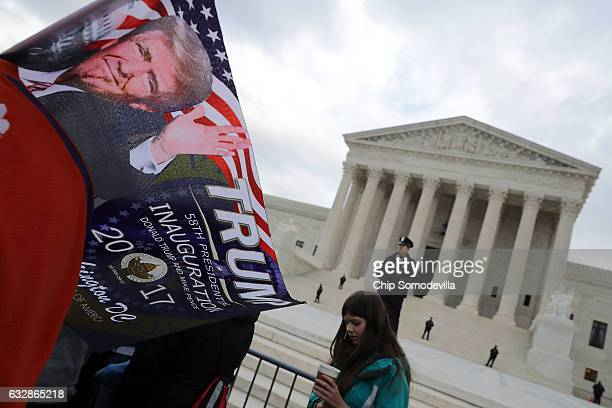 An antiabortion protesters carries a flag celebrating the inauguration of President Donald Trump outside the US Supreme Court building during the...