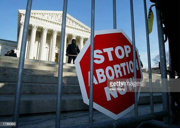 An antiabortion sign attached to a gate is shown during a demonstration in front of the US Supreme Court January 22 2003 in Washington DC Today...