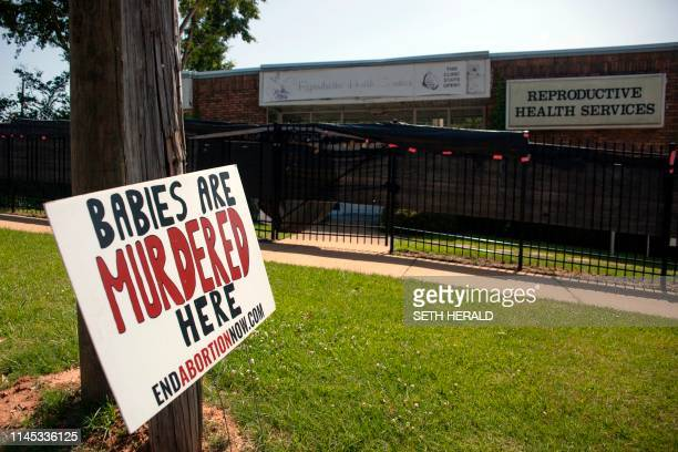 An antiabortion sign is placed outside of the Reproductive Health Services building in Montgomery Alabama on May 20 2019 Abortion is among the most...