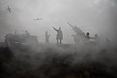 An anti-aircraft cannon and Military silhouettes fighting scene on war fog sky background. Allied air forces attacking on German positions. Artwork decorated scene.