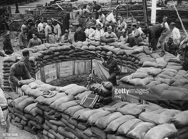 An antiaircraft gun in a trench constructed of sandbags during an exhibition of wartime defence in Paris 13th June 1939