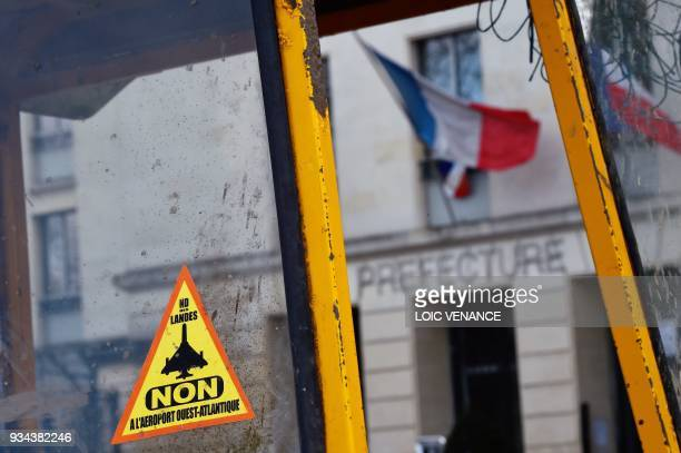 An anti-airport sticker is seen during a gathering by opponents to the scrapped controversial Notre-Dame-des-Landes airport project and ZAD...