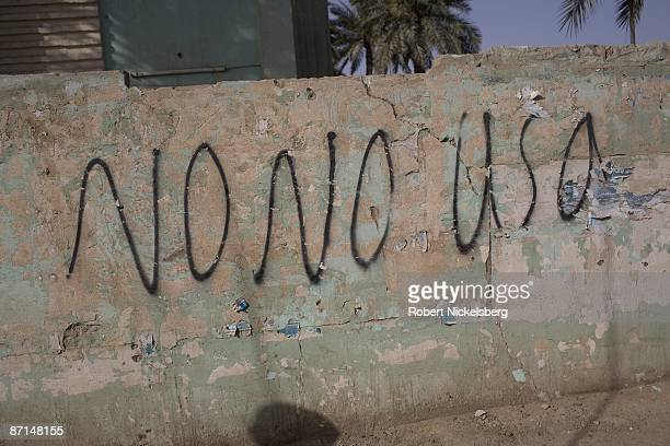 An antiAmerican slogan is clearly visible outside an Iraqi Army command post in Sadr City the 25 million Shia dominated stronghold of cleric Moktada...