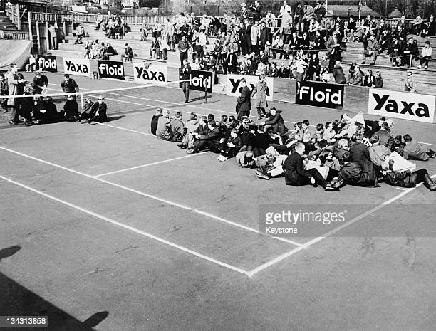 An anti-apartheid demonstration in Oslo, Norway, 16th May 1964. The sit-down protest took place on the Madserud Tennis Court during the Davis Cup...