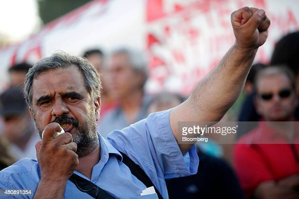 An antibailout protestor shouts slogans and raises his fist as he demonstrates during a rally outside the Greek parliament in central Athens Greece...