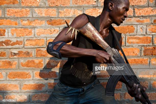An antibalaka militiamen who was a former member of the Central African Armed Forces takes part in a training session on the outskirts of Bangui on...