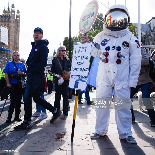 An antiBrexit activist dressed as an astronaut stands in Parliament Square at the end of the route taken by the mass 'Together for the Final Say'...