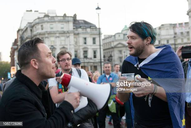 An antiBrexit campaign supporter is seen trying to explain why Brexit is a bad idea to a leave campaign supporter during a huge demonstration...