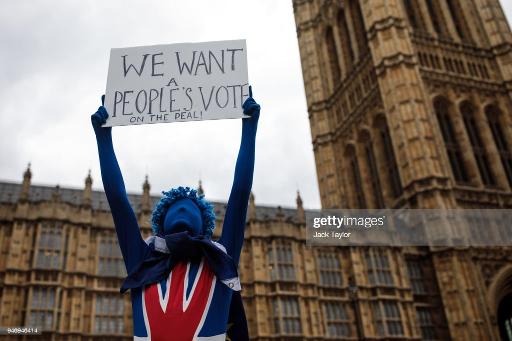 An anti-brexit campaigner holds up a placard during a protest outside the Houses of Parliament as MPs return following the Easter break on April 16, 2018 in London, England. British and European Union officials have begun a new round of Brexit discussions in Brussels today.