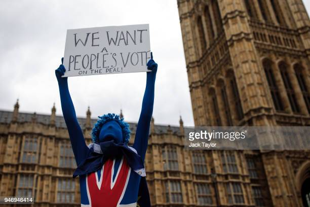 An antibrexit campaigner holds up a placard during a protest outside the Houses of Parliament as MPs return following the Easter break on April 16...
