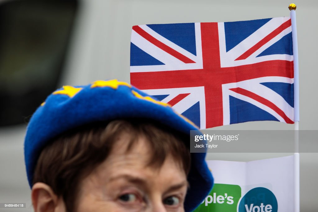An anti-brexit campaigner protests outside the Houses of Parliament with a Union Jack flag as MPs return following the Easter break on April 16, 2018 in London, England. British and European Union officials have begun a new round of Brexit discussions in Brussels today.