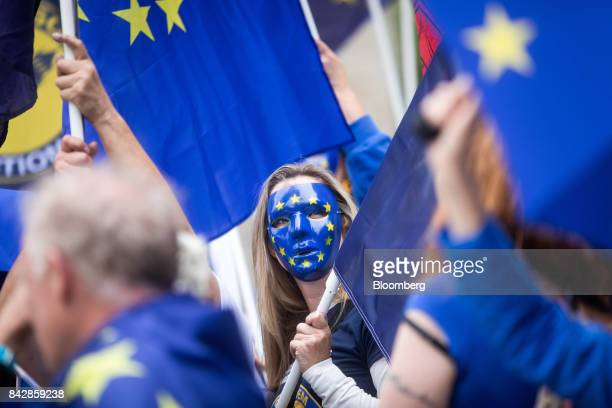An antiBrexit demonstrator wears a European Union mask as she protests outside Houses of Parliament in London UK on Tuesday Sept 5 2017 UK Prime...