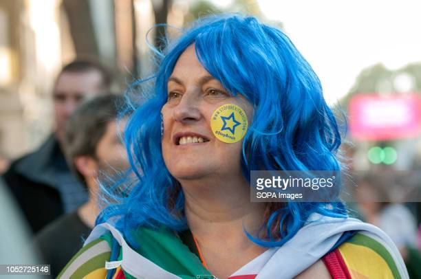 An antiBrexit protester is seen with blue hair wing during a huge demonstration organised by the People's vote campaign The rally gathered at Park...