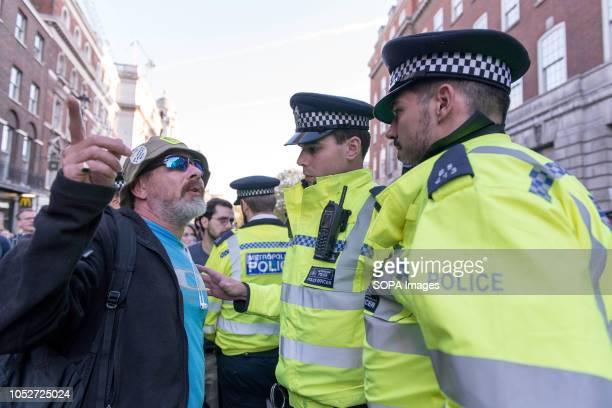 An antiBrexit protester seen talking with a police officer during a huge demonstration organised by the People's vote campaign The rally gathered at...