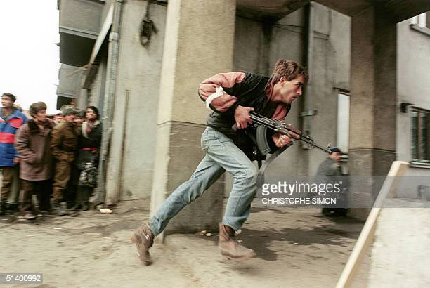 An antiCommunist civilian fighter armed with a Kalachnikov AK47 chases the supposedly Securitate secret police agents loyal to the communist power...