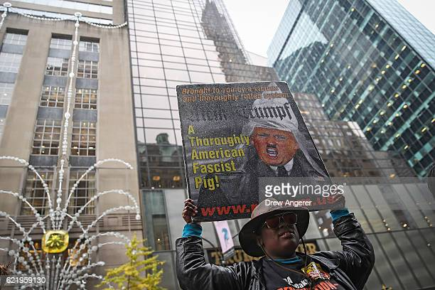An antiDonald Trump protestors stands outside Trump Tower November 9 2016 in New York City Republican candidate Donald Trump won the 2016...