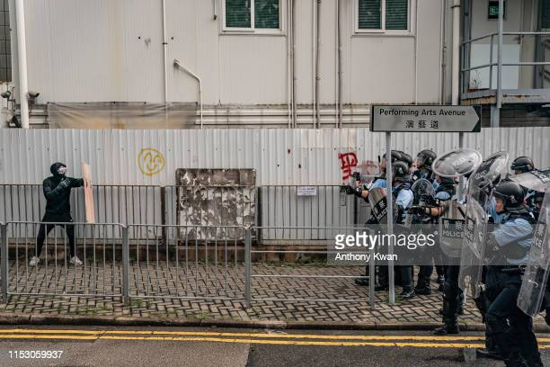 An antiextradition protester uses a makeshift shield during a standoff with police outside the Legislative Council Complex ahead of the annual flag...