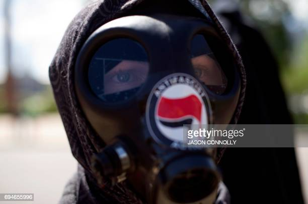 An Antifa demonstrator participates in the Denver March Against Sharia Law in Denver Colorado on June 10 2017 The march was supported by two...