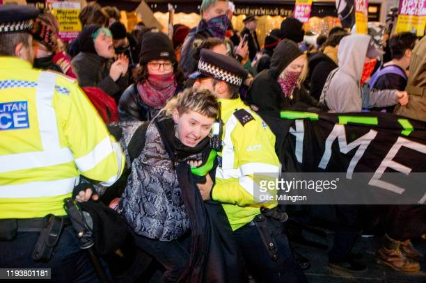 An Antifa group holds an AntiBoris Johnson march through Leicester Square as thousands of people head out for night out in central London in response...