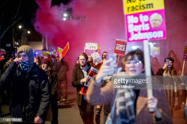 An Antifa group holds an AntiBoris Johnson protest clashing aggressively with The Metropolitan Police along The River Thames past Parliament and into...