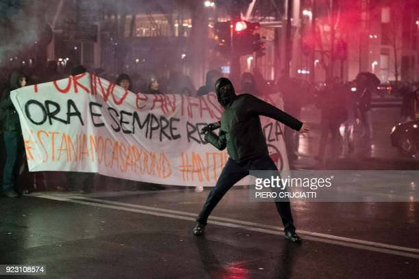 An Antifascist activist throws a bottle at police officers during a rally against an election campaign meeting organized by far-right movement...