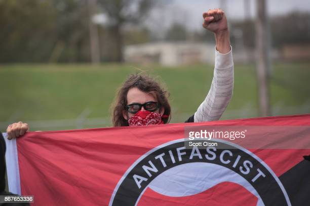 An anti-fascist demonstrator, also known as Antifa, taunts participants as they arrive for a white nationalist's rally on October 28, 2017 in...