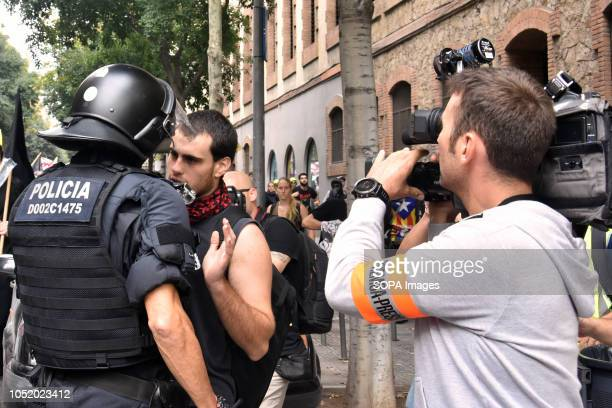 An antifascist protester seen speaking to the riot police officer during an antifascist protest against 'Spanishism' in Barcelona during the...