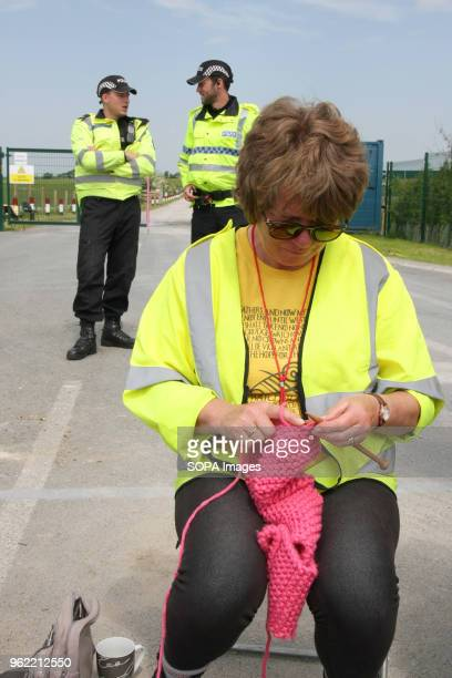 An AntiFrack Protester known as a Nana knits at the gates of Fracking company Cuadrilla's Frack site during a quiet day of continuing protests...