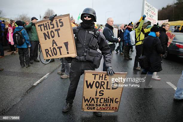 An antifracking campaigner dressed as a riot policeman takes part in a protest march near to the IGas Barton Moss fracking exploration rig on January...