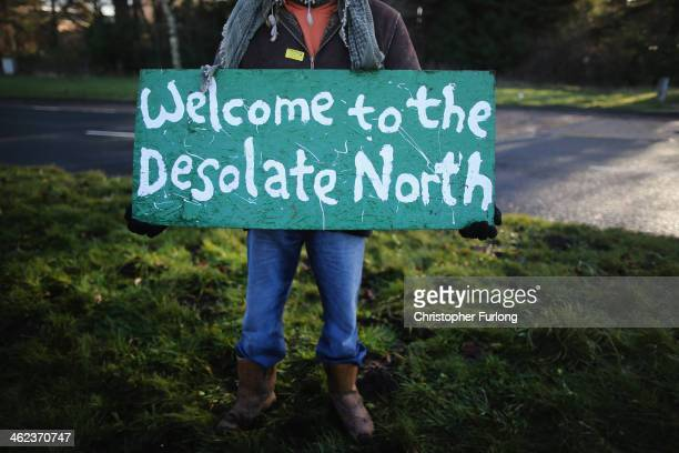 An antifracking protestor holds a placard outside the Barton Moss gas fracking facility on January 13 2014 in Barton England Environmental protestors...