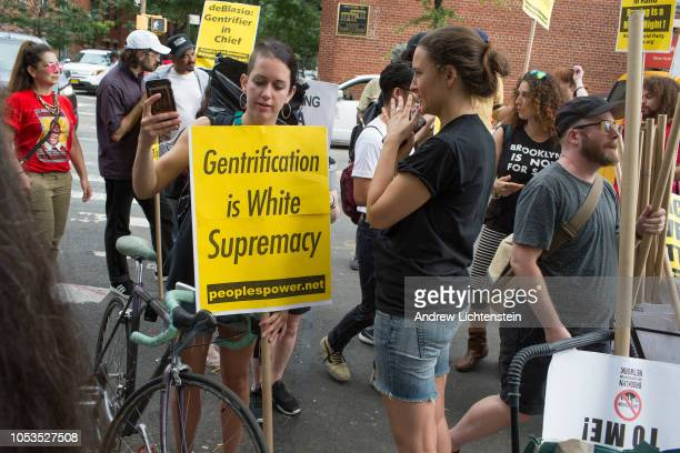 An antigentrification march winds its way through the Gowns neighborhood on September 15 2018 in Brooklyn New York