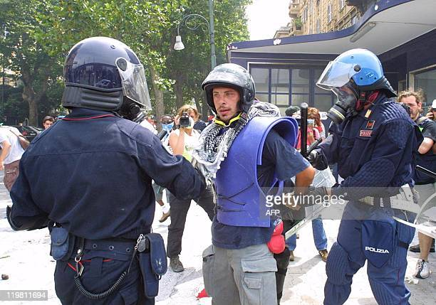 An antiglobalization activist is arrested by security forces during a rally against the Group of Eight summit in Genoa 20 July 2001 Leaders from the...