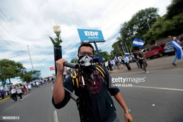 An antigovernement demonstrator takes part in a march in support of the Mothers of April movement whose children died in the protests on Nicaragua's...