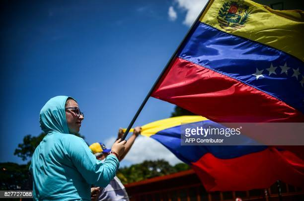 TOPSHOT An antigovernment activist demonstrates against Venezuelan President Nicolas Maduro at a barricade set up on a road in Caracas on August 8...