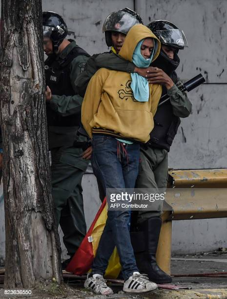 An antigovernment activist is arrested by members of the National Guard during clashes in Caracas on July 27 2017 on the second day of a 48hour...
