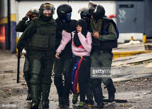 TOPSHOT An antigovernment activist is arrested during clashes in Caracas on July 28 2017 Protesters took over streets in Caracas on Friday in a show...