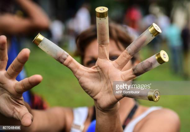 TOPSHOT An antigovernment activist shows bullet cases during a protest in Venezuela's third city Valencia on August 6 a day after a new assembly with...