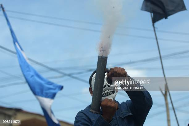 TOPSHOT An antigovernment demonstrator fires a homemade mortar at Monimbo neighbourhood in Masaya Nicaragua on July 11 2018 The known death toll from...