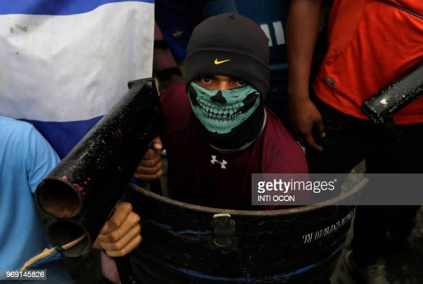 An antigovernment demonstrator holds a makeshift mortar during protests in the town of Masaya 35 km from Managua on June 5 2018 From little boys with...