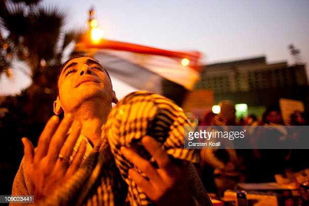 An antigovernment demonstrator prays as he celebrates in Tahrir Square upon hearing the news of the resignation of Egyptian President Hosni Mubarak...